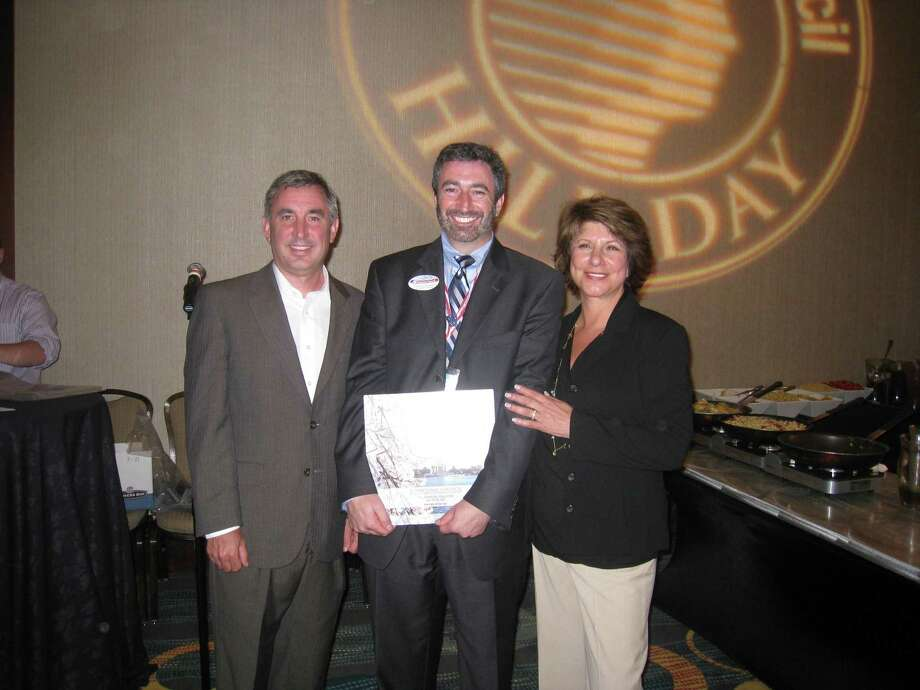 Submitted photo Barry Simon, center, receives the Advocate of the Year award. At left is Jim Swinfard, chairman of the Public Policy Committee and at right, Linda Rosenberg, president and CEO of the National Council for Community Behavioral Healthcare.