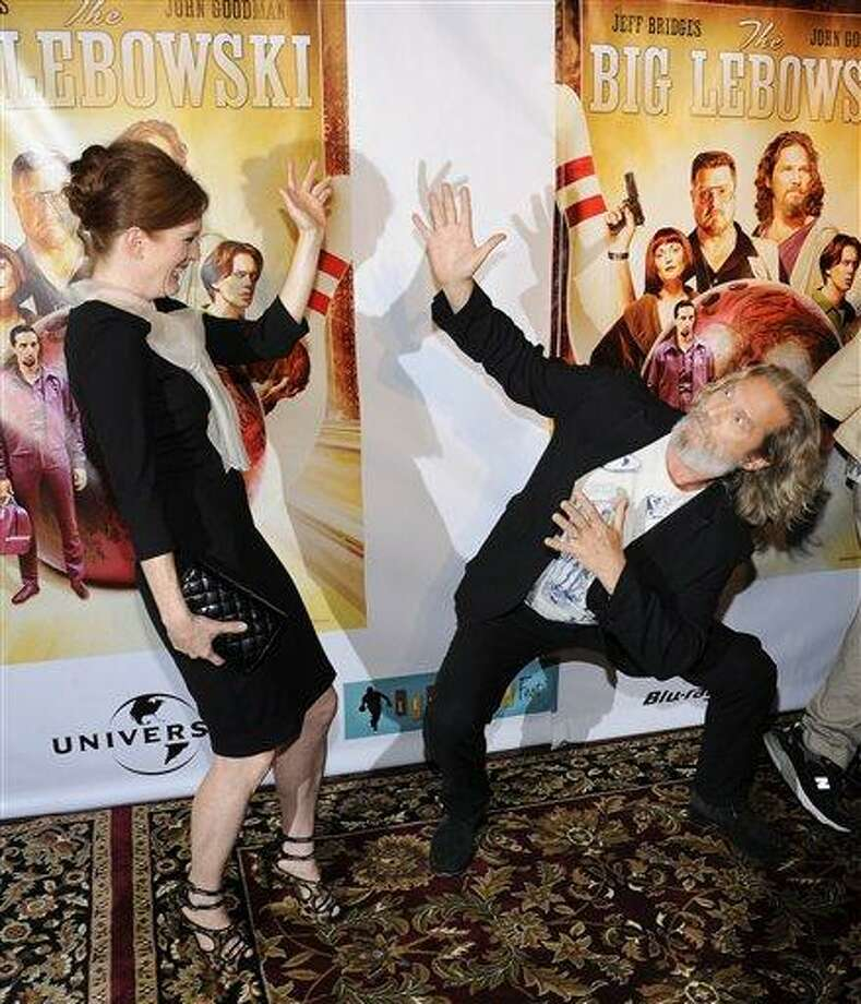 """Actress Julianne Moore and actor Jeff Bridges attend """"The Big Lebowski"""" limited edition Blu-Ray DVD launch event at The Hammerstein Ballroom on Tuesday, Aug. 16, 2011 in New York. (AP Photo/Evan Agostini) Photo: AP / 2011 AP"""