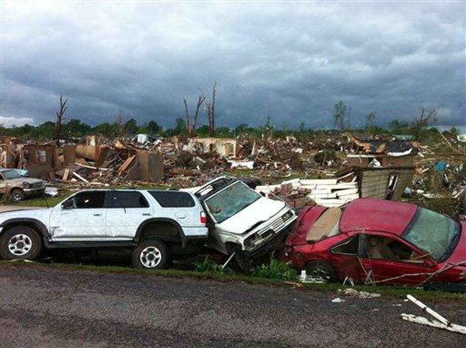 A tornado has flattened Pleasant Grove, Ala., a subdivision of Mountain Grove, Thursday, April 28. 2011. Dozens of tornadoes spawned by a powerful storm system wiped out entire towns across a wide swath of the South, killing at least 194 people, and officials said Thursday they expect the death toll to rise.  (AP Photo/Greg Bluestein) Photo: AP / AP