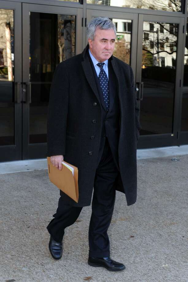 """Attorney Michael """"Mickey"""" Sherman leaves U.S. District Court in Bridgeport, Conn., Wednesday, Dec. 22, 2010. Sherman an attorney who represented Kennedy cousin Michael Skakel in his murder trial was sentenced Wednesday to one year and one day in federal prison for failing to pay about $420,000 in income taxes. (AP Photo/The Connecticut Post, Ned Gerard) Photo: AP / Connecticut Post"""
