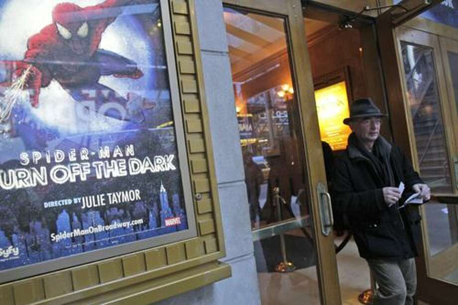 "Tom Zahner, of Cologne, Germany, leaves the Spider Man box office after purchasing tickets, Tuesday, Dec. 21, 2010 in New York.  The troubled Broadway musical ""Spider-Man: Turn Off the Dark"" was plagued by its fourth accident since it began previews last month when a performer doing an aerial stunt fell about 30 feet, fire officials said.(AP Photo/Mary Altaffer) Photo: ASSOCIATED PRESS / AP2010"
