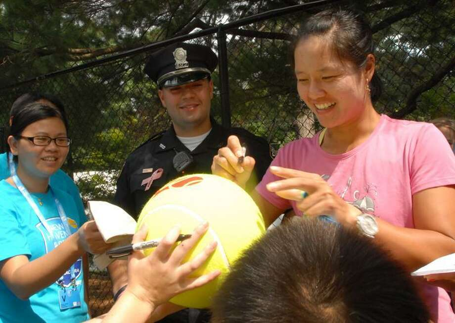Li Na, the second seed as a Wild Card  in the  WTA New Haven Open, signs autographs for fans Sunday 8/21/11 at the Connecticut Tennis Center in New Haven.  Photo by Peter Hvizdak / New Haven Register August 21, 2011      ph2346             Connecticut