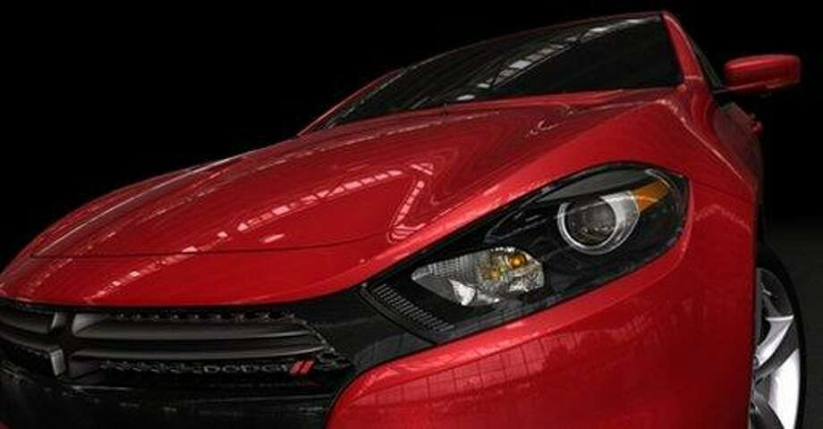 This product photo provided by the Chrysler Group LLC, shows a partial view of the 2013 Dodge Dart, named after the 1960s small car that gearheads often turned into a street racer. The Dart is due in showrooms during the first half of next year.  Associated Press Photo: AP / Chrysler Group LLC