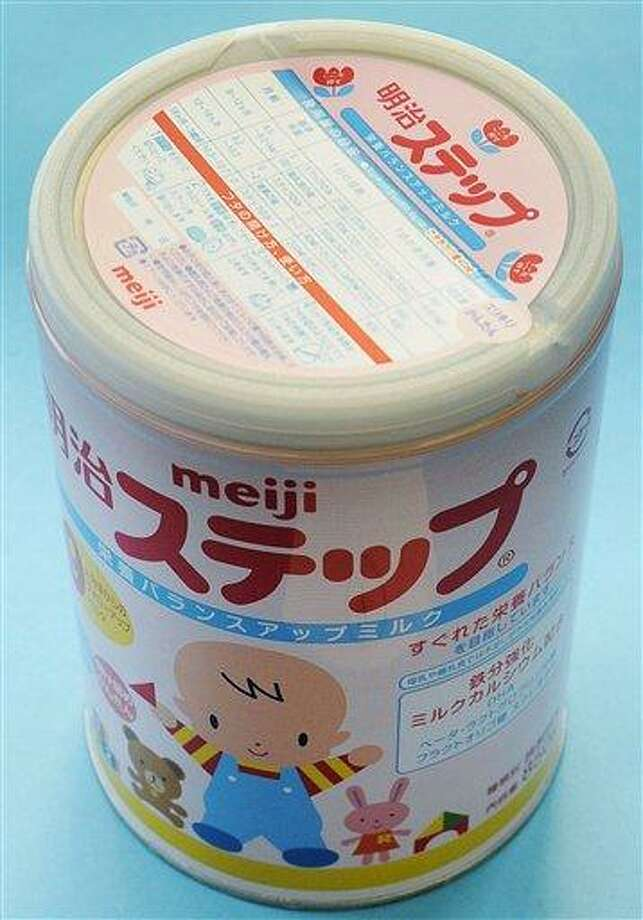 In this photo taken Tuesday, a canned powdered milk for infants, Meiji Step, manufactured and sold by Japan's major food and candy maker Meiji Co., is shown. Traces of radiation from the hobbled Japanese nuclear plant were detected in baby formula Tuesday in the latest in a string of contaminated food discoveries in this nation. Meiji recalled the canned powdered milk, with expiration dates of October 2012, but the company said the levels of radioactive cesium found were so low that they would not affect health.  Associated Press Photo: ASSOCIATED PRESS / AP2011