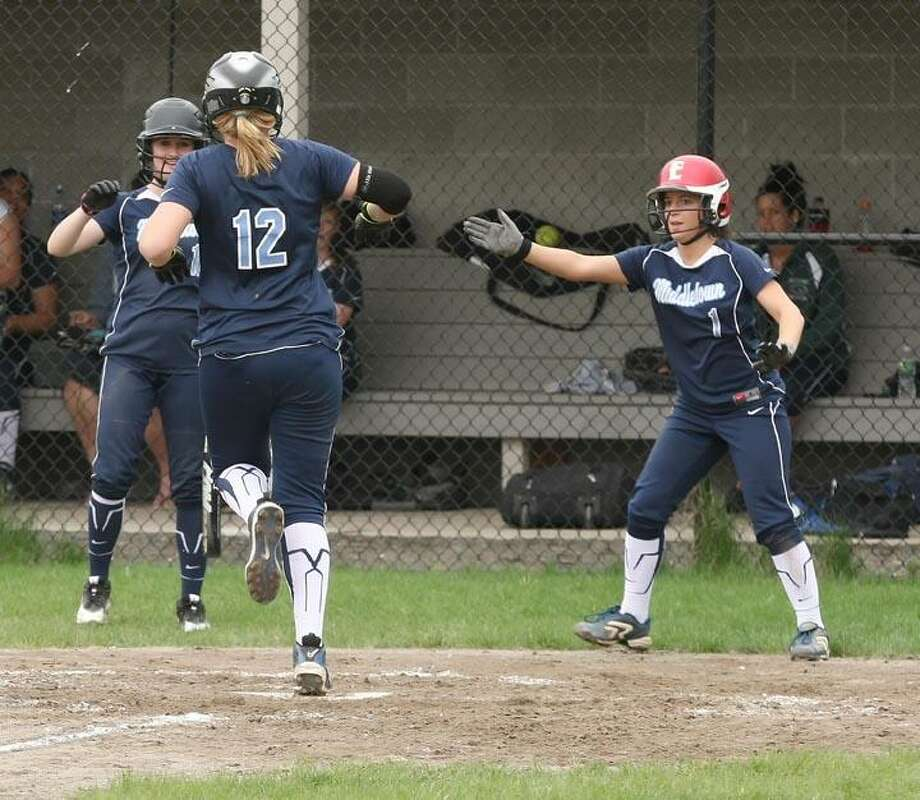 Todd Kalif/Special to The Press  Middletown's Katherine Mosca and Cara Brainard welcome Ashley Tucker at the plate at the end of her home run in the second inning of Middletown's 3-0 softball win over Plainville on Wednesday.