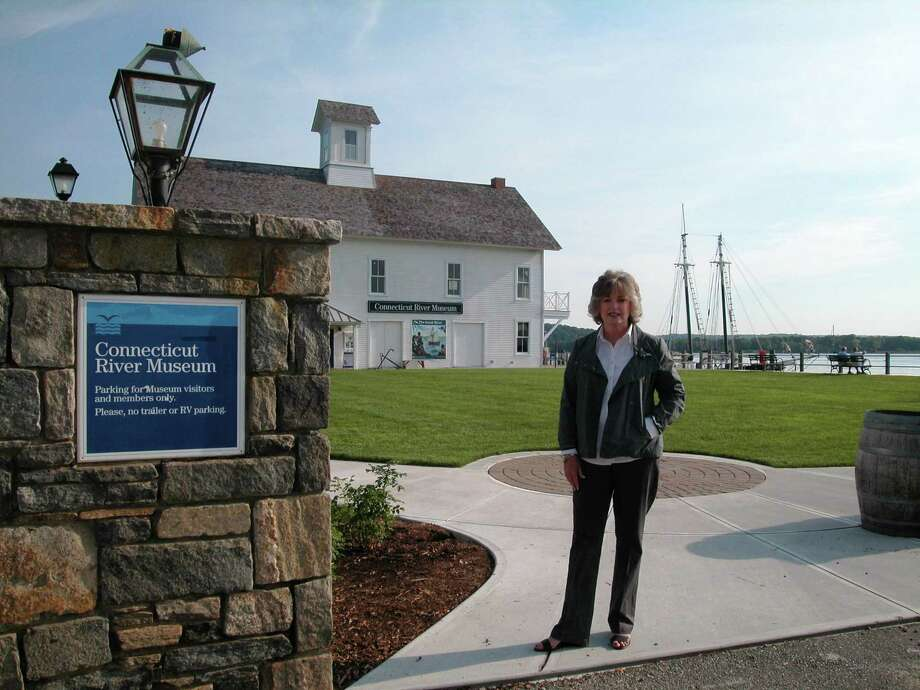 Maureen O'Grady, the newly elected Chairman of the Board Trustees of the Connecticut River Museum, at the entrance of the Museum's recently restored grounds and building overlooking Essex Harbor.