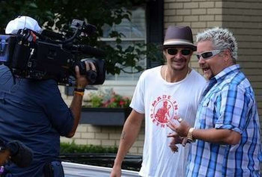 (right) Guy Fieri, host of the Food Network's Diners, Drive-ins and Dives, with special guest Kid Rock,  during filming of the show at the Clarkston Union restaurant in downtown Clarkston, Thursday August 18, 2011. (Oakland Press Photo: Vaughn Gurganian) Photo: The Oakland Press / The Oakland Press
