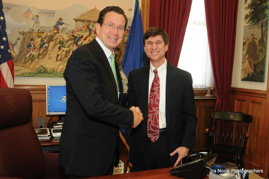 Photo by Ira Nozik Photographers Gov. Dannel Malloy, left, and Gary Jones, the Anti-Defamation League's Connecticut regional director.
