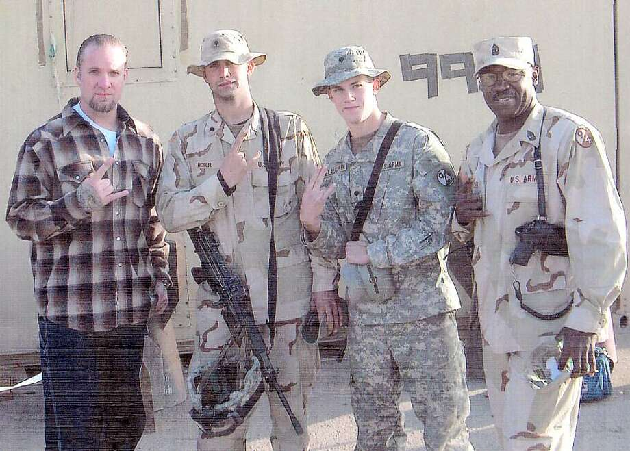 Submitted photo Kenneth Fletcher 1SG, far right, is pictured in Balad, Iraq, with Jesse James, Spc. Justin Derr and Spc. Arron Mclaughlin of East Hampton in this 2006 photo.