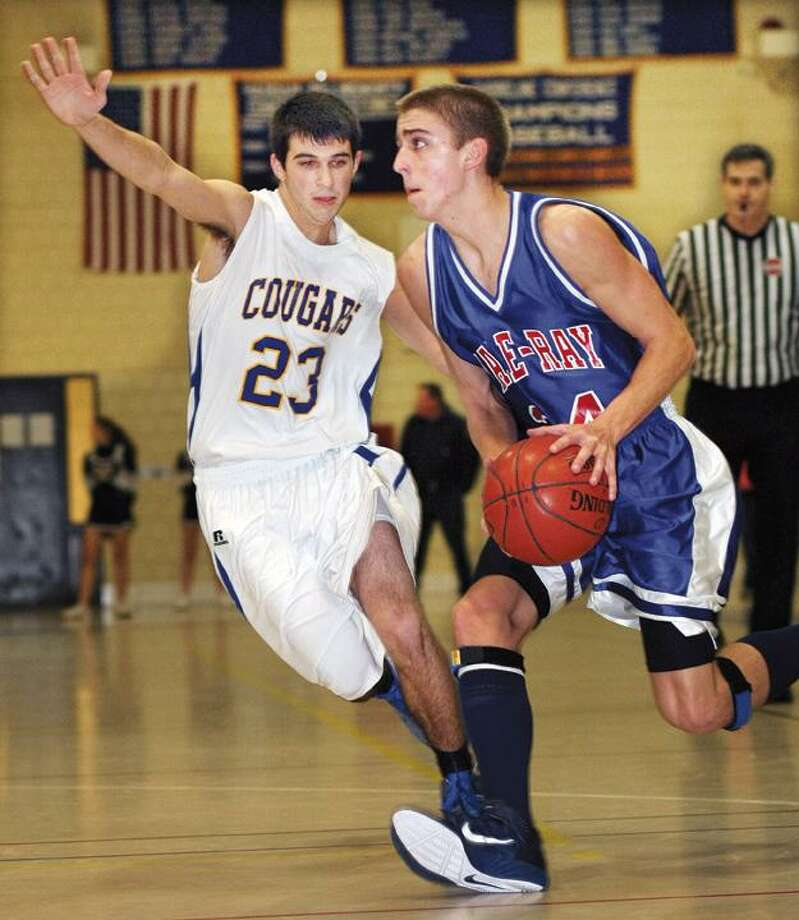 """The Middletown Press  12.22.10  Hale Ray's Pat Miett goes for a layup in the Hale Ray-Haddam-Killingowrth boys' basketball game on Wednesday.  Hale Ray won, 54-36. To buy a glossy print of this photo and more, visit <a href=""""http://www.middletownpress.com"""">www.middletownpress.com</a>."""
