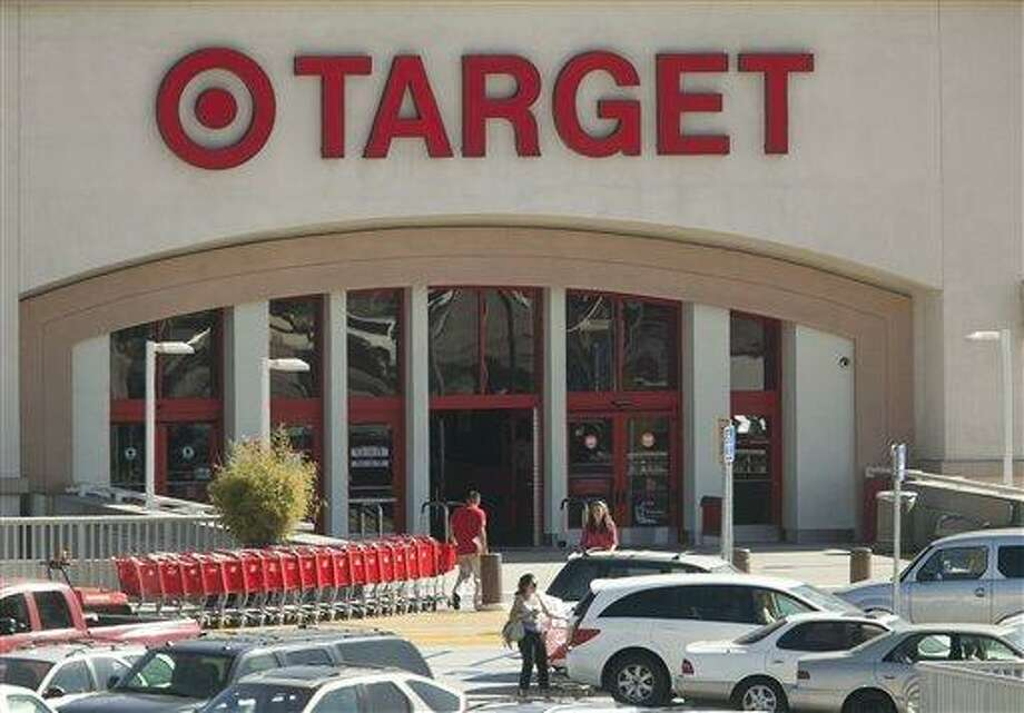 In this photo taken on Tuesday, July 16, 2011, customers shop at Target Eagle Rock store in Los Angeles. Target Corp., buoyed by its push into groceries and incentives it offers credit cardholders, posted a 3.7 percent increase in second-quarter profit and said earnings for the year will beat Wall Street estimates. (AP Photo/Damian Dovarganes) Photo: ASSOCIATED PRESS / AP2011
