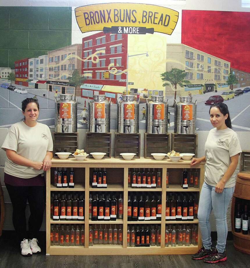 Jennifer Connolly, left, and Sandra Monroy of Bronx Buns, Bread stand by the vinegar and infused oils display at the new bakery on Mill Plain Road in Danbury, Conn., on Thursday, Aug. 17, 2017. Photo: Chris Bosak / Hearst Connecticut Media / The News-Times