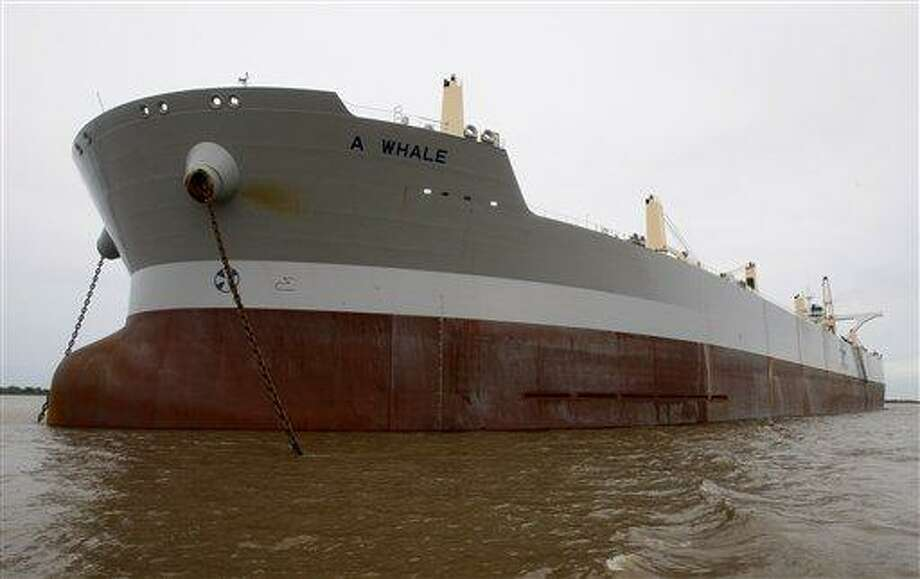 """The """"A Whale"""" skimmer, billed as the world's largest oil skimming vessel, is seen anchored on the Mississippi River in Boothville, La., Wednesday. The ship is the length of 3 1/2 football fields and 10 stories high, and is designed to collect up to 500,000 barrels of oily water a day through 12 vents on either side of its bow. (AP) Photo: ASSOCIATED PRESS / FR158704 AP"""