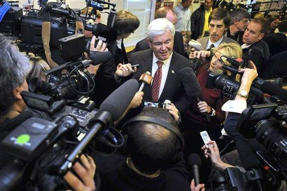 FILE - In this Nov. 30, 2011 file photo, Republican presidential candidate, former House Speaker Newt Gingrich speaks at Tommy's Ham House in Greenville ,  S.C.  For three decades, the Republican who won South Carolina's presidential primary has also won the GOP nomination. That strong record helps explain why Gingrich is working more aggressively than any of his competitors to organize activists and volunteers ahead of the Jan. 21 primary. His chief rival, Mitt Romney, is approaching South Carolina tentatively. (AP Photo/Richard Shiro, File) Photo: AP / FR159523 AP