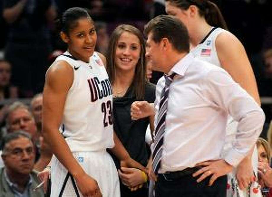 AP Connecticut's Maya Moore, right, and coach Geno Auriemma celebrate in the second half of a game during the Maggie Dixon Classic at Madison Square Garden in New York, Sunday. Connecticut won their 88th game in a row, 81-50. The Huskies go for a historic 89th straight win tonight.