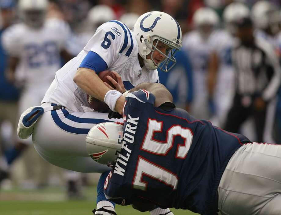 Indianapolis Colts quarterback Dan Orlovsky (6) is sacked by New England Patriots nose tackle Vince Wilfork (75) during the first quarter of their NFL football game in Foxborough, Mass., Sunday afternoon, Dec. 4, 2011. (AP Photo/Elise Amendola) Photo: AP / AP2011