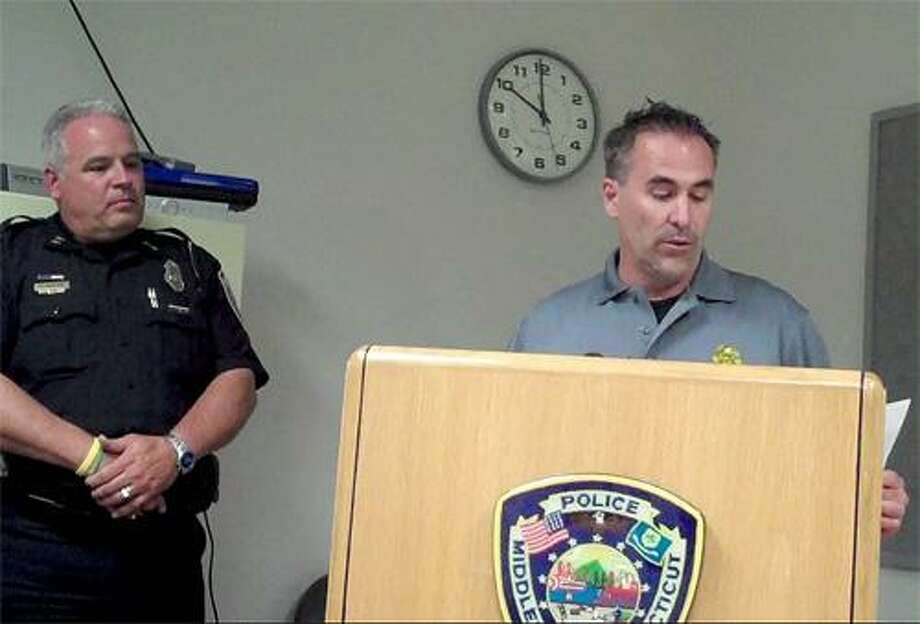 Viktoria Sundqvist I The Middletown PressCapt. William McKenna, right, describes the Middletown Police Department's Operation Expanded Shield while Acting Police Chief Patrick McMahon listens Thursday at police department headquarters in Middletown.