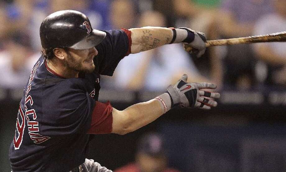 ASSOCIATED PRESS Boston Red Sox catcher Jarrod Saltalamacchia hits a three-run home run during the fifth inning of Friday's game against the Kansas City Royals in Kansas City, Mo. The Red Sox won 7-1.