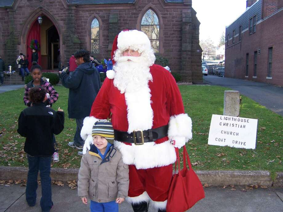 Skylar Gunerard, 4, stands next to Santa for pictures.