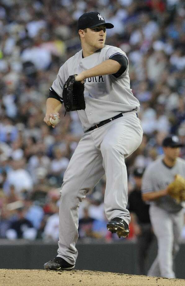 ASSOCIATED PRESS New York Yankees pitcher Phil Hughes throws against the Minnesota Twins in the first inning of Friday's game in Minneapolis. The Yankees won 8-1. Hughes threw 7 2-3 innings and gave up just two hits.