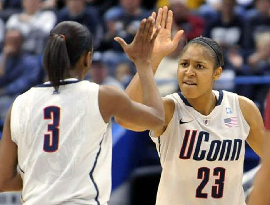 Connecticut forward Maya Moore (23) reacts with teammate Tiffany Hayes (3) in the first half of a college basketball game against Florida State in Hartford, Conn., Tuesday, Dec. 21, 2010. Heading into the game, Connecticut needed one win to set the NCAA record for consecutive wins by a basketball team. (AP Photo/Jessica Hill) Photo: ASSOCIATED PRESS / AP2010