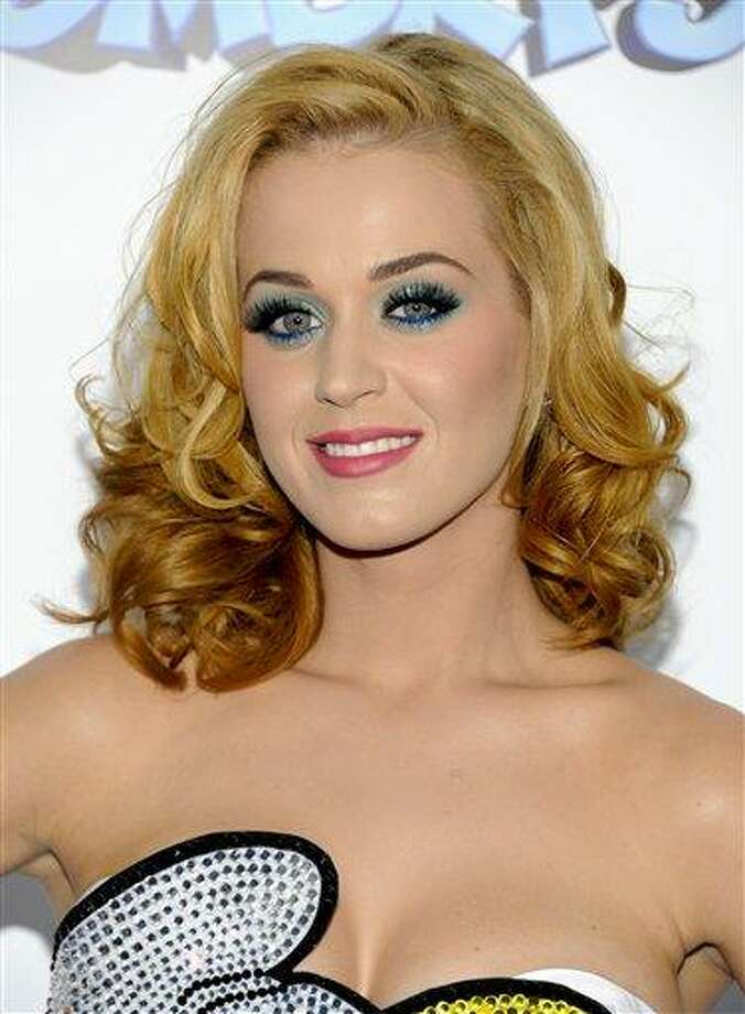 """In this July 24, 2011 file photo, singer Katy Perry attends the premiere of """"The Smurfs"""" at the Ziegfeld Theatre in New York. Perry proven she's a multi-hit wonder, becoming the first woman to score five No. 1 songs from one album on the Billboard Hot 100 chart. (AP Photo/Evan Agostini, file) Photo: AP / AGOEV"""