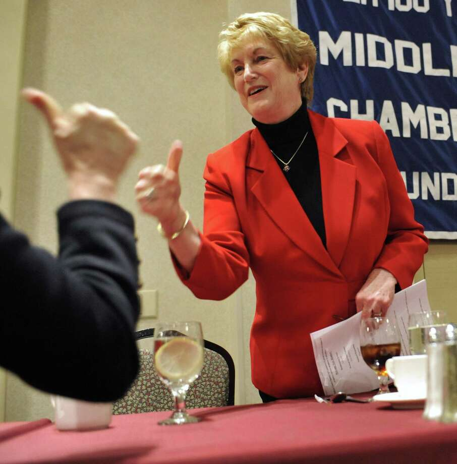 In this Monday, Dec. 13, 2010 photo, Connecticut Gov. M. Jodi Rell gives the thumbs up to a chamber member at the Middlesex County Chamber of Commerce Breakfast in Cromwell, Conn. The first chapter of M. Jodi Rell's governorship of Connecticut began amid turmoil as she was thrust into the office after her predecessor amid a corruption scandal and later went to prison. (AP Photo/Jessica Hill) Photo: AP / AP2010