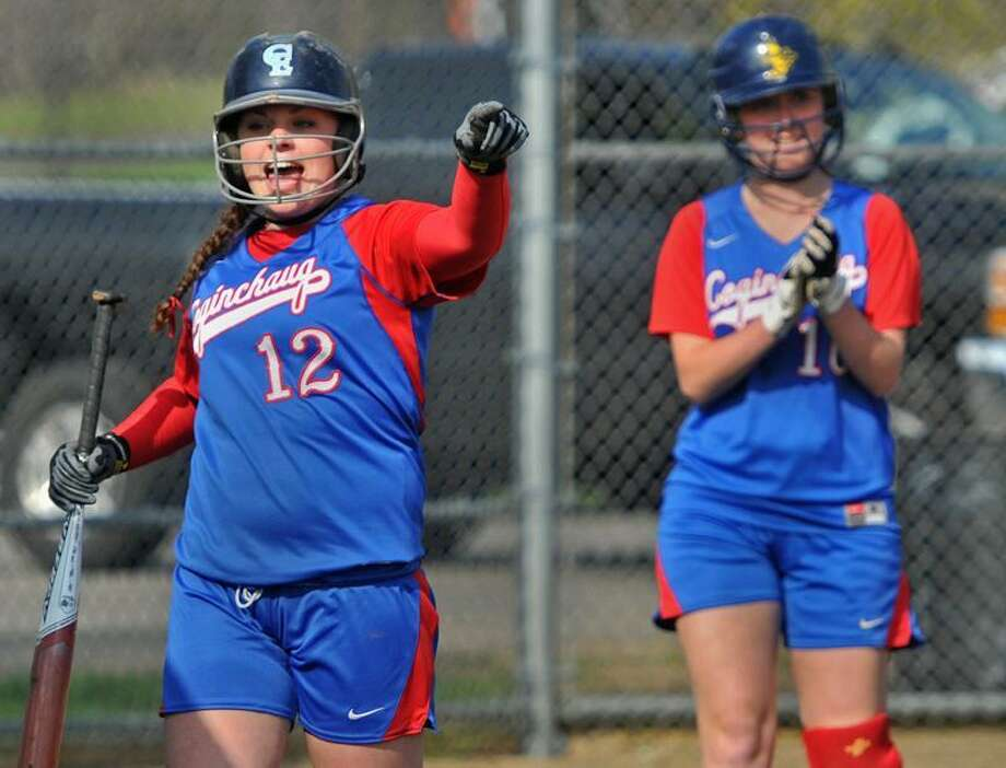 After both runners crossed the plate, Mari Handley and Ashley Vanaman cheer on a Coginchaug teammate who drove them in during Monday's victory over Old Lyme. Photo by Brad Horrigan/New Haven Register