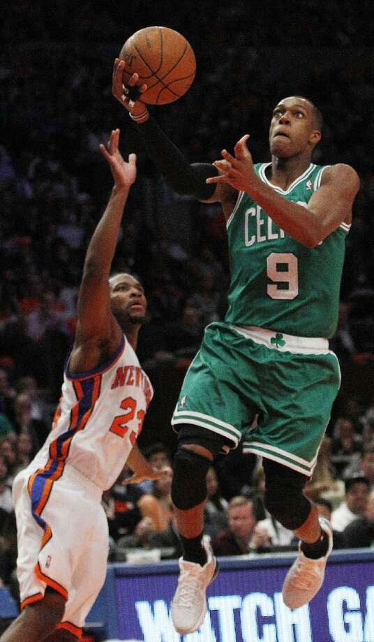 ASSOCIATED PRESS Boston Celtics guard Rajon Rondo (9) drives past New York Knicks guard Toney Douglas (23) during the second half of Game 3 in a first-round NBA playoff series Friday at Madison Square Garden in New York. The Celtics won the game 113-96. Boston looks to close out the series this afternoon in Game 4.