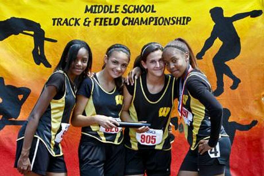 The Woodrow Wilson Middle School girls 4x100 meter relay team placed first and broke the meet record at the Connecticut Middle School Track and Field Championships on Saturday, June 5. Their time of 50.62 seconds shattered their previous meet record and also placed them as the third best relay team in the country this past season. From left to right: Arabia Henley, Marissa Aldieri, Mikaela Coady and Rajeen Mayo. All four are also members of the National Junior Honor Society. (Sandy Aldieri / Submitted to the Press)