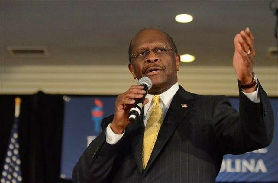 Republican presidential candidate Herman Cain speaks to supporters at The Magnolia Room at Laurel Creek  Friday, Dec. 2, 2011,  in Rock Hill,  S.C.  (AP Photo/ Richard Shiro) Photo: AP / (2011) Richard Shiro