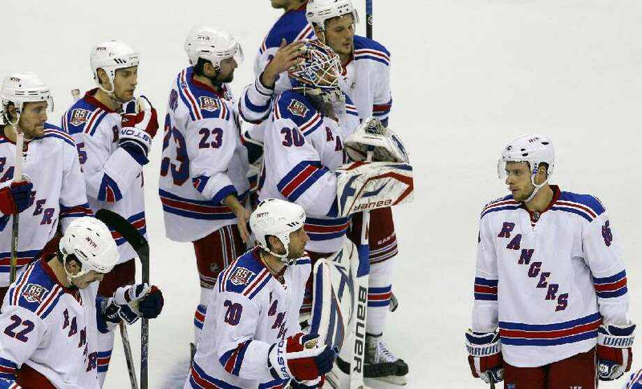 ASSOCIATED PRESS New York Rangers react around New York Rangers goalie Henrik Lundqvist (30), after Game 5 of a first-round NHL Stanley Cup playoff series with the Washington Capitals Saturday in Washington. The Capitals won 3-1 and took the series in five games.