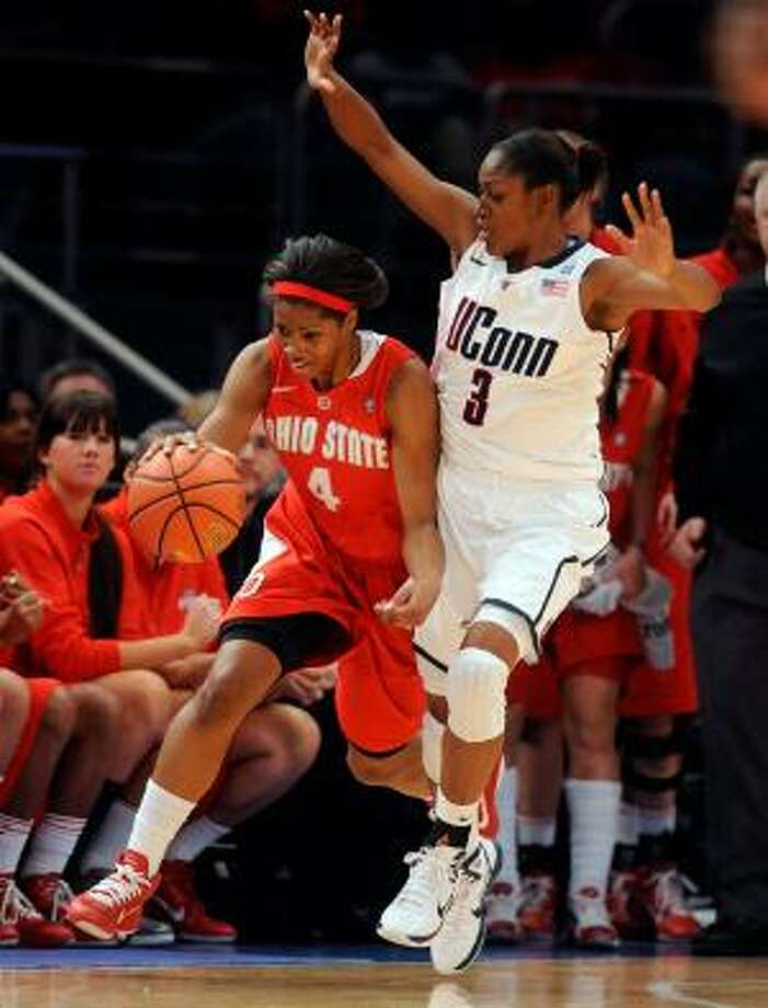 AP Ohio State's Tayler Hill, left, brings the ball up against Connecticut's Tiffany Hayes in the first half of a game in the Maggie Dixon Classic at Madison Square Garden in New York, Sunday. The Huskies won 81-50, giving them 88 straight wins. UConn tied UCLA for the most consecutive wins all-time Sunday. The Huskies look to break the all-time record Tuesday at home against Florida State.