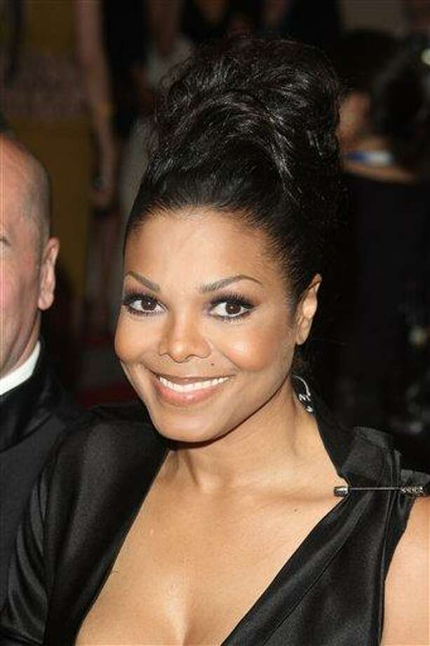 FILE - Janet Jackson arrives at the Metropolitan Museum of Art Costume Institute gala, in New York. Jackson marks her stage return Friday, July 2, 2010  after two years away with an opening night performance during the Essence Music Festival at the Louisiana Superdome in New Orleans. (AP Photo/Peter Kramer, File) Photo: AP / AP2010