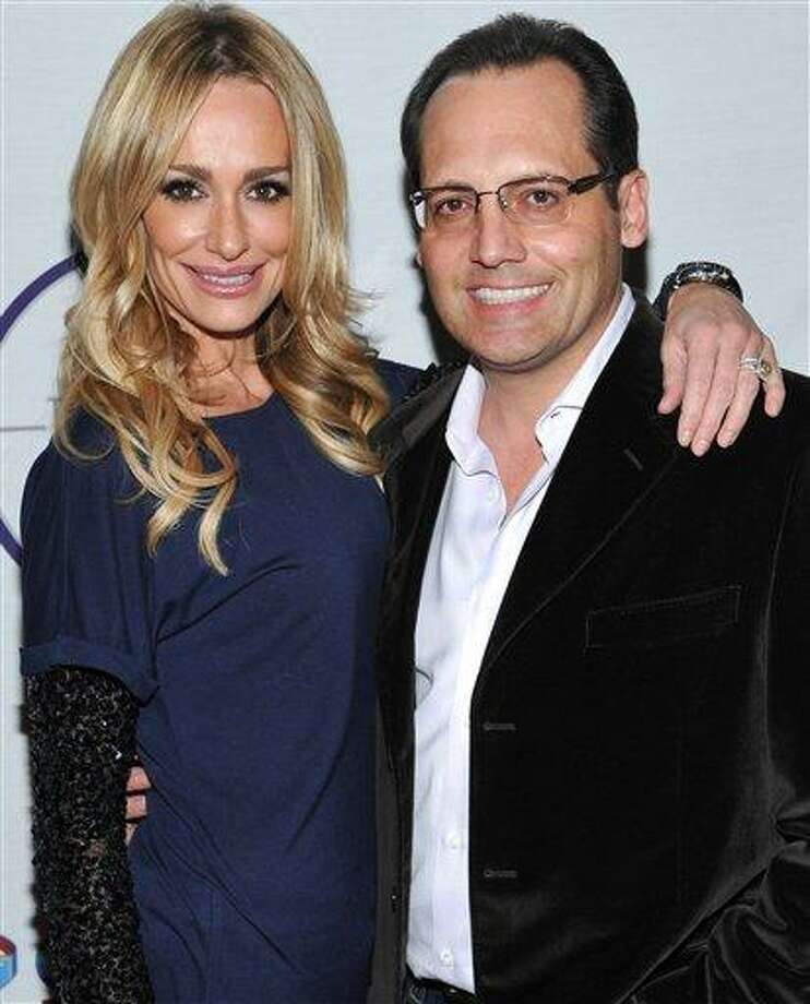 """In this Feb. 5,2011 file photo, television personality Taylor Armstrong, left, and husband Russell Armstrong attend a Super Bowl party in Dallas, Texas. Russell Armstrong, the estranged husband of """"Real Housewives of Beverly Hills"""" star Taylor Armstrong, has been found dead in his Los Angeles home. (AP Photo/Evan Agostini,File) Photo: AP / AP2011"""