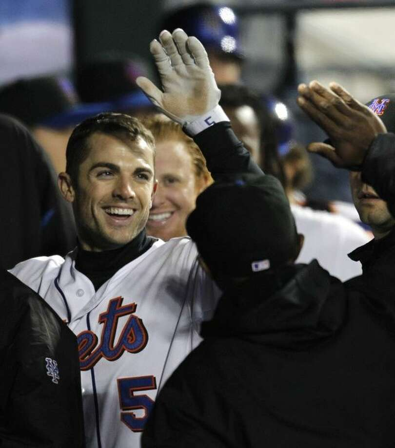 New York Mets greet David Wright (5) after his fourth-inning solo home run off Houston Astros starting pitcher J.A. Happ in a baseball game in New York, Thursday, April 21, 2011. (AP Photo/Kathy Willens) Photo: ASSOCIATED PRESS / AP2011