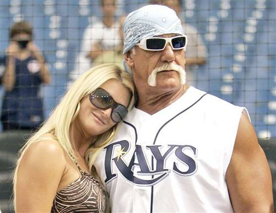 FILE - In this Sept. 3, 2008 file photo, restler Hulk Hogan, right, and his then girlfriend, Jennifer McDaniel, watch the New York Yankees take batting practice before a baseball game against the Tampa Bay Rays in St. Petersburg, Fla. The celebrity wrestler and McDaniel were married at Hogan's Clearwater Beach home Tuesday, Dec. 14, 2010, during a small, private ceremony, his attorney said. (AP Photo/Chris O'Meara, File) Photo: AP / AP2008
