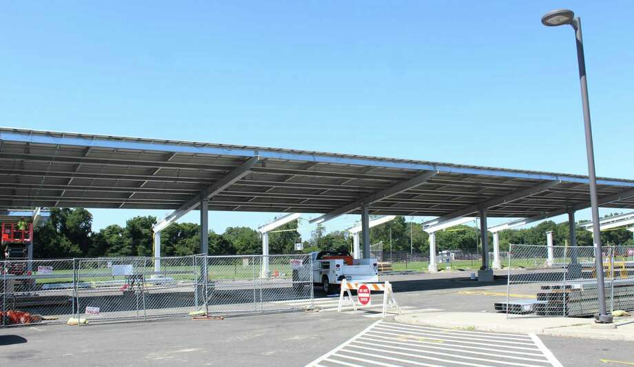 Solar panel carports being built at Fairfield Warde High School.Solar panel carports in the student lots at both Fairfield Warde and Fairfield Ludlowe high schools will be finished by the time school opens for the new academic year. Fairfield,CT. 8/17/17 Photo: Genevieve Reilly / Hearst Connecticut Media / Fairfield Citizen