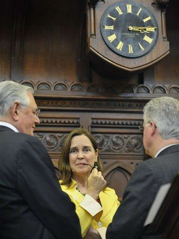 House Majority Leader Denise Merrill D-Mansfield, center, talks with Speaker of the House Christopher Donovan, right, and Robert Frankel, left, during veto override sessions in the House at the Capitol in Hartford on June 21.   (AP Photo/Jessica Hill) Photo: AP / AP2010