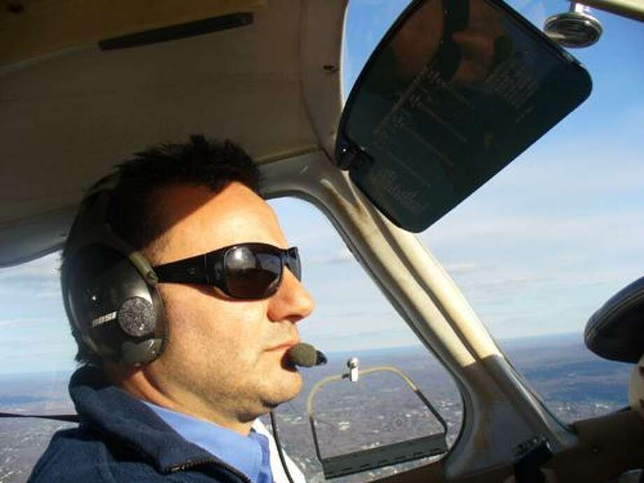 In this undated photo, pilot and flight school owner Arian Prevalla flies in a Piper Warrior, over Hartford, Conn. (AP Photo/The Journal Inquirer, Daniel Hatch) Photo: AP / The Journal Inquirer