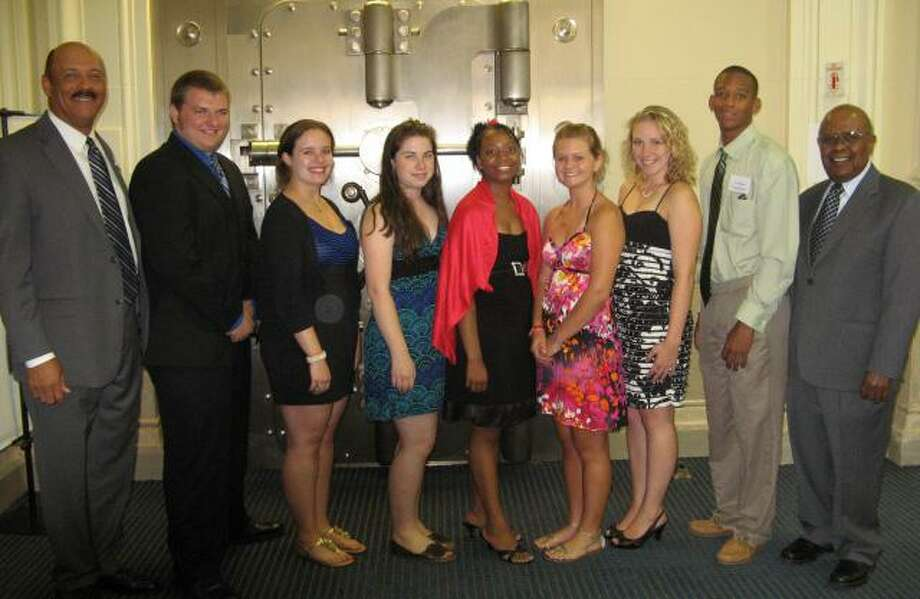 Six students from the Greater Middletown area were awarded $5,000 scholarships from the Liberty Bank Foundation yesterday at a reception held at the bank's main office in Middletown.  Pictured left to right are Liberty Bank President and CEO Chandler J. Howard; Cody Given, graduate of Coginchaug High School; Melanie Flood and Lauren Kingston, graduates of Valley Regional High School; Mariah Perry, graduate of Middletown High School; Bryce Chornoby, graduate of Norwich Free Academy; Jennifer Thompson, graduate of Cheshire High School; Tony Woolard, graduate of Middletown High School; and Willard McRae, chairman of the foundation's scholarship selection committee.