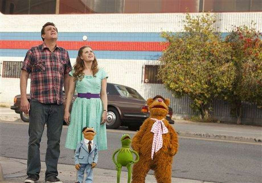 "In this image released by Disney, Jason Segel, left and Amy Adams are shown with muppet characters Walter, Kermit and Fozzie Bear in a scene from the film, ""The Muppets."" (AP Photo/Disney, Scott Garfield) Photo: AP / ©Disney Enterprises, Inc. All Rights Reserved."