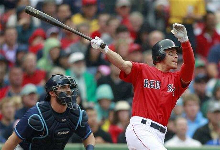 Boston Red Sox's Jacoby Ellsbury, right, hits a three-run home run in front of Tampa Bay Rays catcher Kelly Shoppach in the third inning of the first game of a baseball doubleheader in Boston, Tuesday, Aug. 16, 2011. (AP Photo/Michael Dwyer) Photo: ASSOCIATED PRESS / AP2011