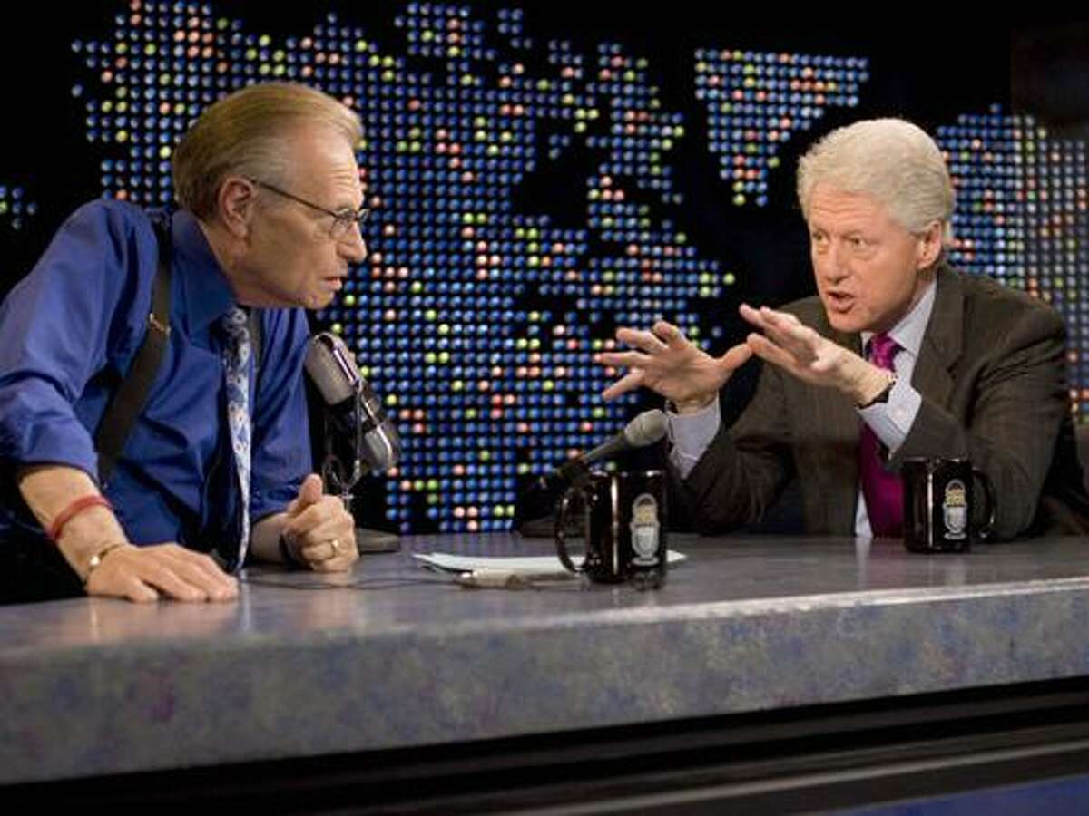 FILE - In this April 19, 2007 file photo supplied by CNN, Larry King interviews former President Bill Clinton, right, on CNN's