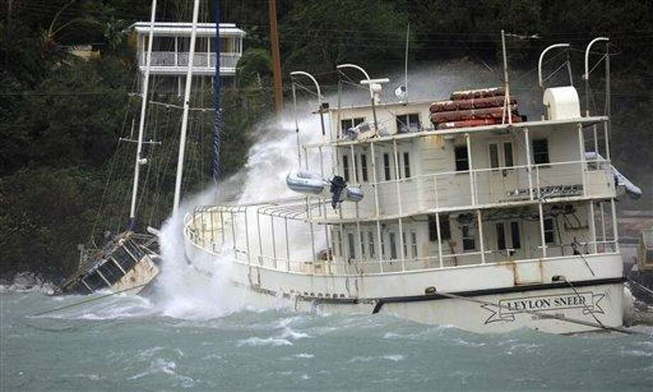 A boat is battered by waves in Sopers Hole during the passage of Hurricane Earl near Tortola, British Virgin Islands, Monday Aug. 30, 2010. The Category 4 hurricane was expected to remain over the open ocean before turning north and running parallel to the U.S. coast, potentially reaching the North Carolina coastal region by late Thursday or early Friday. (AP Photo/Todd VanSickle) Photo: AP / AP