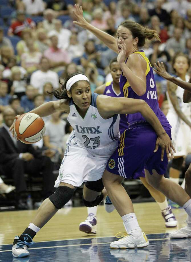 Minnesota Lynx forward Maya Moore, left, looks to pass against Los Angeles Sparks guard Jenna O'Hea during the second half of a WNBA basketball game, Tuesday, July 26, 2011, in Minneapolis. (AP Photo/Stacy Bengs) Photo: ASSOCIATED PRESS / AP2011
