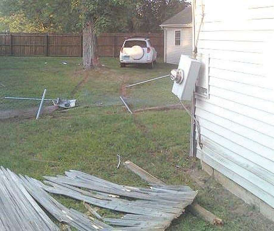 This car came to rest by the garage behind 98 Court Street after it crashed through two fences and clipped a tree Tuesday afternoon, according to Cromwell police.