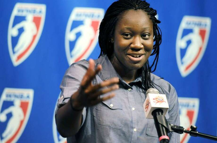 Connecticut Sun's Tina Charles addresses the media after she was presented with the WNBA Rookie of the Year award during a news conference Tuesday at Mohegan Sun Casino in Uncasville. Charles led the league in rebounding with 398, breaking the league season record in the process. Charles also broke the league record for double-doubles in a season with 22. (AP Photo/The Hartford Courant, Michael McAndrews) Photo: AP / The Hartford Courant
