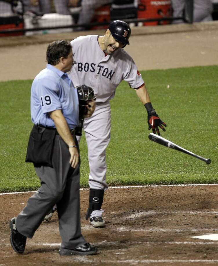 Boston Red Sox's Mike Lowell argues with home plate umpire Ed Rapuano (19) after being called out looking to end the sixth inning of a baseball game against the Baltimore Orioles, Tuesday in Baltimore. The Orioles won 5-2. (AP Photo/Rob Carr) Photo: AP / AP