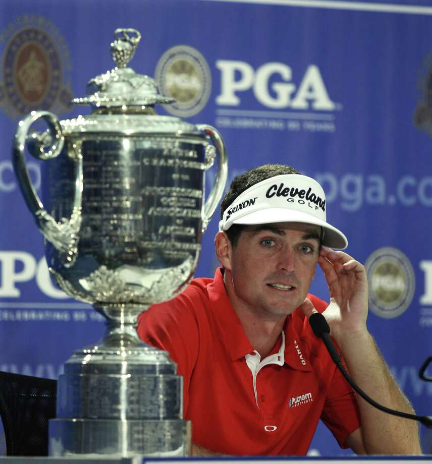 Keegan Bradley answers question during a news conference with the Wanamaker Trophy  after winning a three-hole playoff against Jason Dufner at the PGA Championship golf tournament Sunday, Aug. 14, 2011, at the Atlanta Athletic Club in Johns Creek, Ga.  (AP Photo/Charlie Krupa) Photo: ASSOCIATED PRESS / AP2011